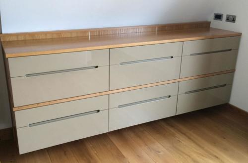 Extra set of drawers added two years later to the high-gloss suspended bedroom cabinets